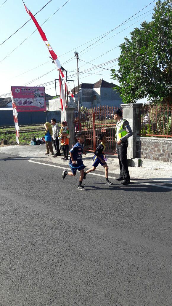 Polres Batu – Sektor Junrejo Amankan Lomba Lari Maraton