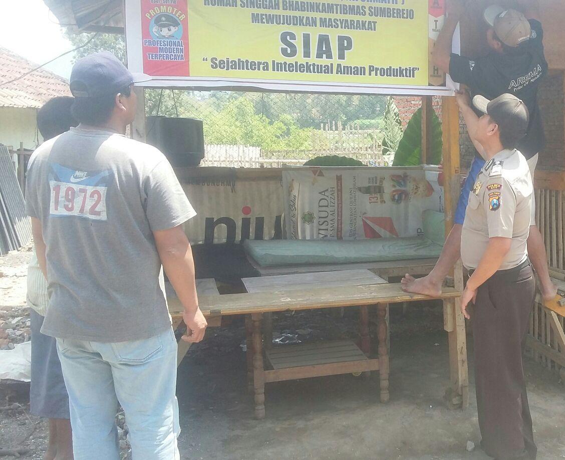 Anggota Bhabinkamtibmas Polsek Batu Kota Polres Batu Giatkan Pengecekan Pos Reaktif Rumah Singgah Desa Binaan