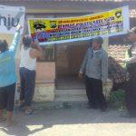 Berikan Rasa Aman, Bhabin Polsek Batu Kota Polres Batu Pasangan Banner Jaga Wilayah Kondusif