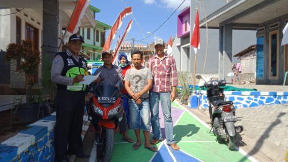 Anggota Bhabinkamtibmas Polsek Pujon Polres Batu Menjadi Team Juri Bersama Perangkat Desa Sukomulyo