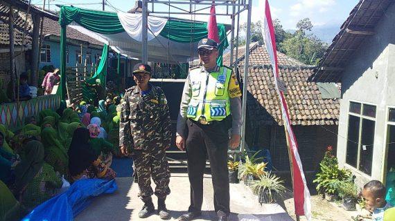 Bhabinkamtibmas Polsek Pujon polres batu Melaksanakan Pengamanan Muslimat  NU