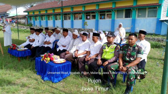 Bhabinkamtibmas Polsek Pujon Polres Batu (3 Pilar) Menghadiri Giat Manasik Haji Di Desa Ngabab