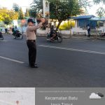 Polsek Batu Polres Batu melaksanakan Giat Poros Pagi Bantu Kelancaran Arus Lalin